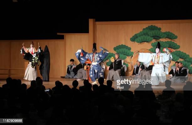 Bunraku puppet performer Yoshida Tamao Kyogen comedian Nomura Mansai and Kabuki actor Ichikawa Ebizo perform during the banquet hosted by the Prime...