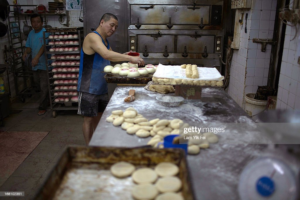 A buns maker prepares buns during the selection contest for the finalists of the Cheung Chau Bun Scrambling Competition in Cheung Chau, on May 5, 2013 in Hong Kong. The Cheung Chau Bun scrambling Competition is a part of Tai Ping Qing Jiao Festival. the Purest Sacrifice celebrated for Great Peace and the day of festivitie ends with guests climbing 20-metre bamboo towers to retrieve 'lucky' buns dotted up their length.
