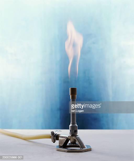 bunsen burner producing flame - bunsen burner stock pictures, royalty-free photos & images