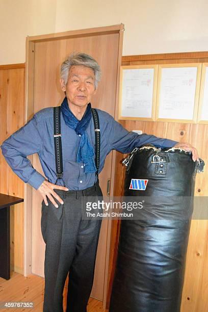 Bunta Sugawara poses with a sandbag in his farm on September 29 2014 in Hokuto Yamanashi Japan Bunta Sugawara a Japanese actor best known for his...