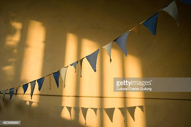 Bunting against yellow wall