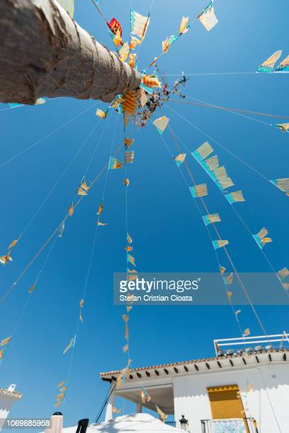 bunting flags on the blue sky background in altea, spain - altea photos et images de collection