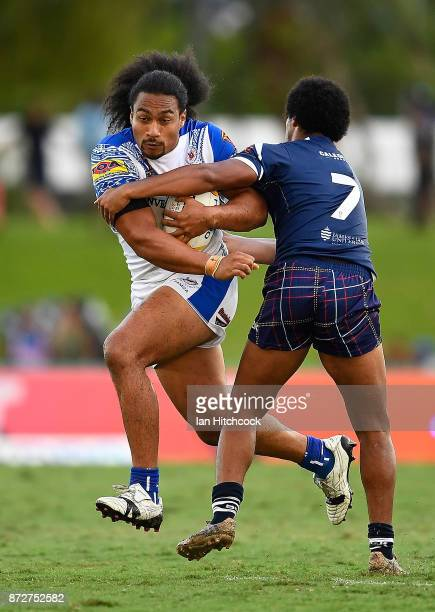 Bunty Afoa of Samoa is tackled by Oscar Thomas of Scotland during the 2017 Rugby League World Cup match between Samoa and Scotland at Barlow Park on...