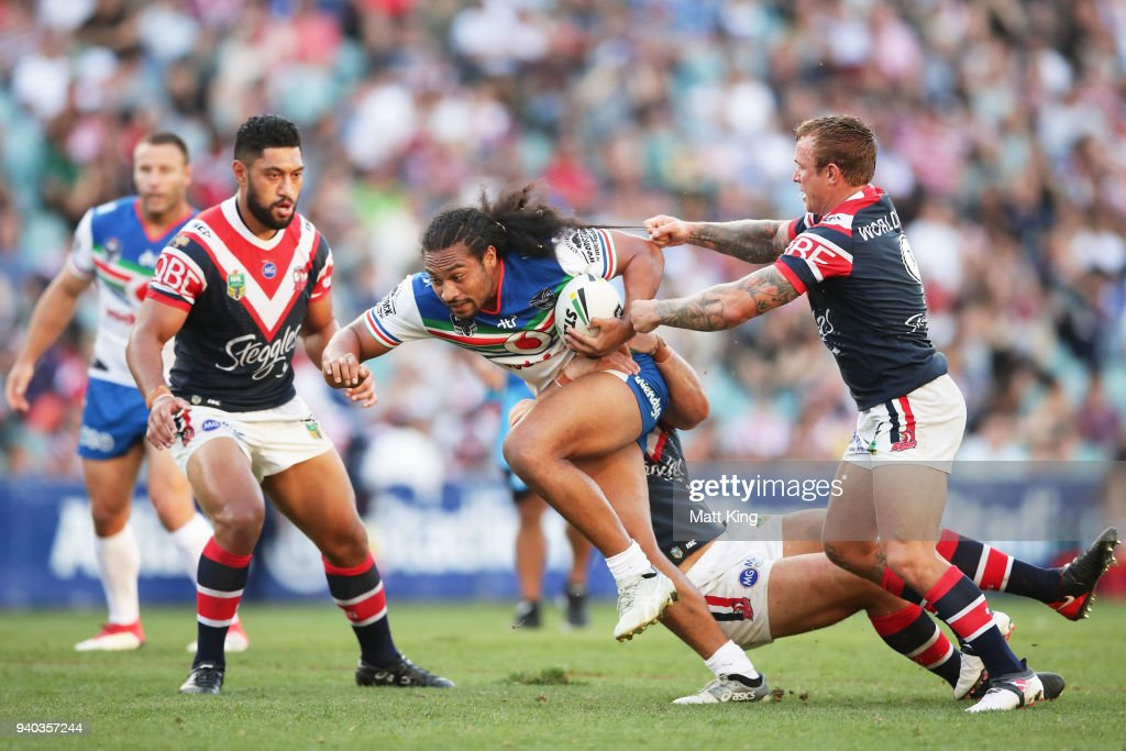 Bunty Afoa of the Warriors is tackled by Jake Friend of the Roosters during the round four NRL match between the Sydney Roosters and the New Zealand Warriors at Allianz Stadium on March 31, 2018 in Sydney, Australia.