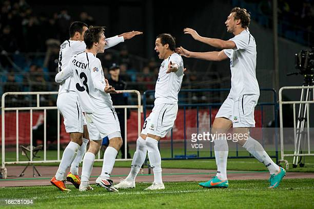 Bunyodkor players celebrate their team's first goal by team mate Fozil Musaev during the AFC Champions League Group match between Beijing Guoan and...