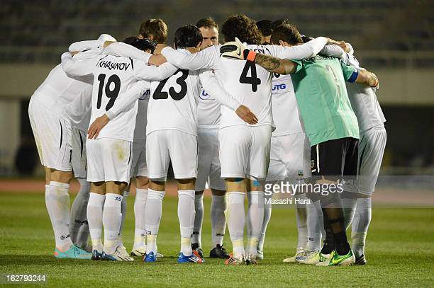 Bunyodkor players huddle during the AFC Champions League Group G match between Sanfrecce Hiroshima and Bunyodkor at Hiroshima Big Arch on February 27...