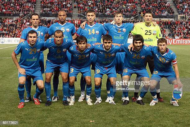 Bunyodkor players pose for a teamshot prior to the AFC Champions League semifinal first leg match between Adelaide United and Bunyodkor at Hindmarsh...