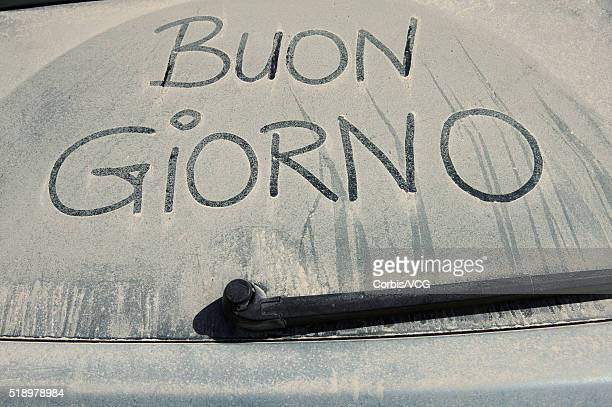 'Buon Giorno' Written in Dirt on Car Window