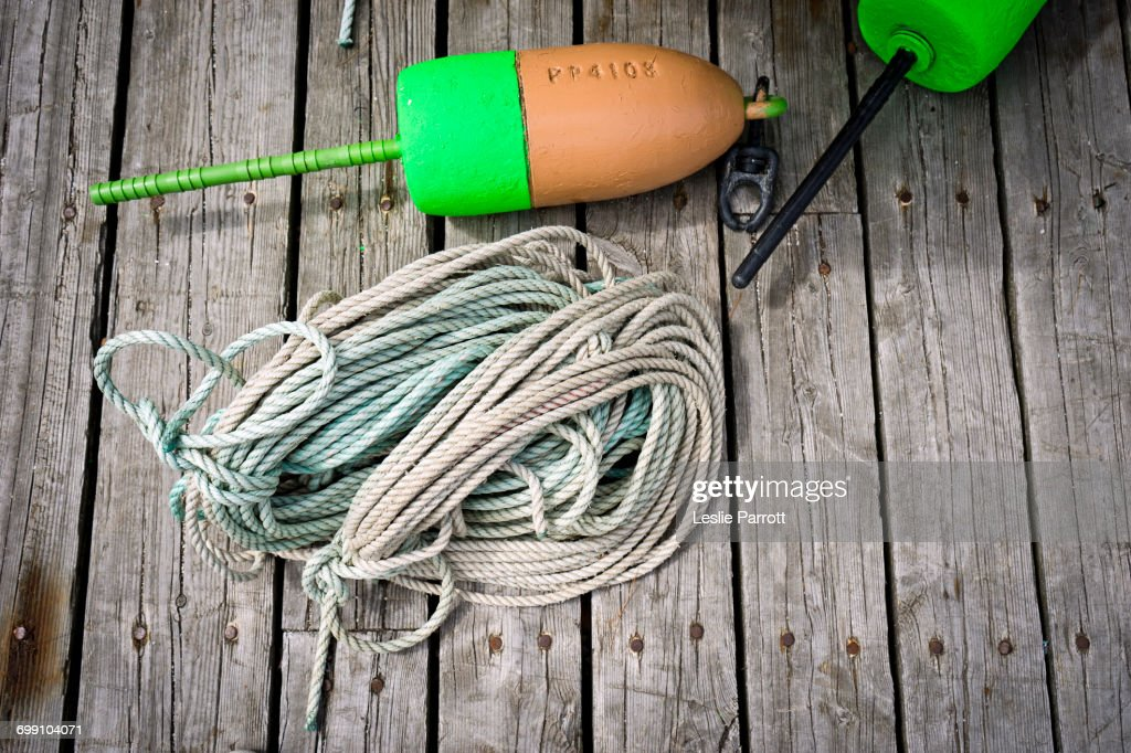 Buoy And Rope On A Dock Stock Photo - Getty Images