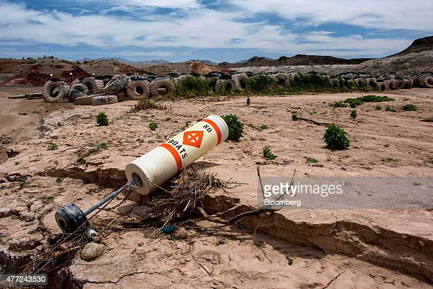 A buoy and truck tires sit on what used to be the bottom of Lake Mead at the abandoned Echo Bay Marina in Overton Nevada US on Thursday June 4 2015...