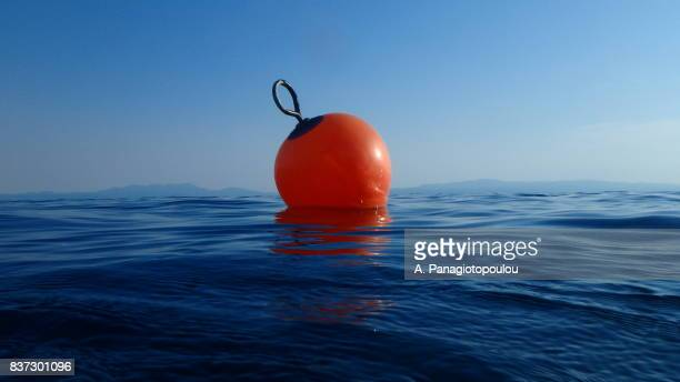 buoy in sea on the island of skopelos, greece - buoy stock photos and pictures