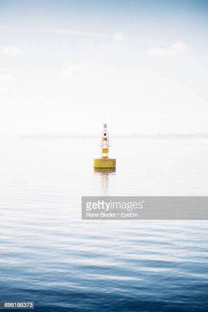 buoy in sea - buoy stock photos and pictures
