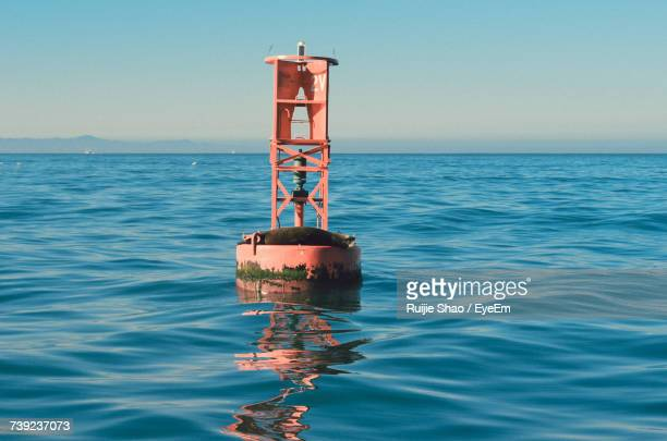 buoy on sea against clear sky - buoy stock photos and pictures