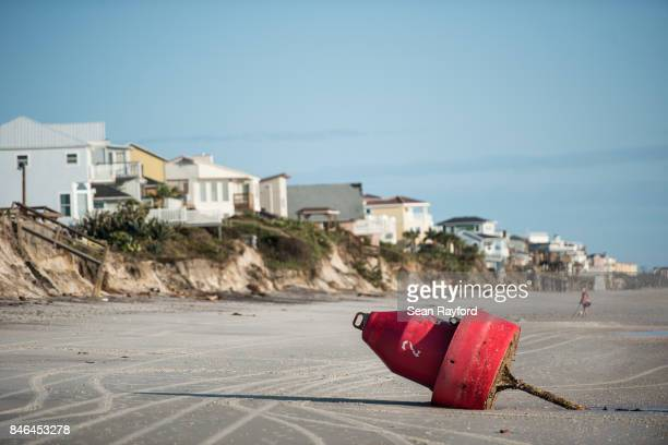 A buoy sits on an eroded beach caused by Hurricane Irma on September 13 2017 in Vilano Beach Florida Nearly 4 million people remained without power...