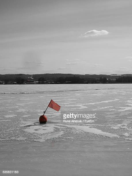 Buoy With Red Flag In River