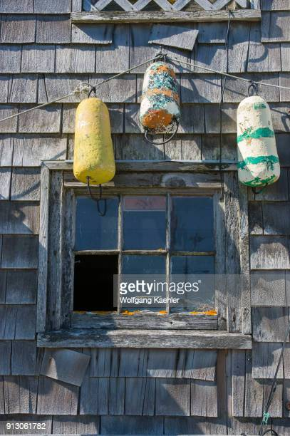 Buoys hanging on fishing hut in the fishing village of Peggy's Cove near Halifax Nova Scotia Canada
