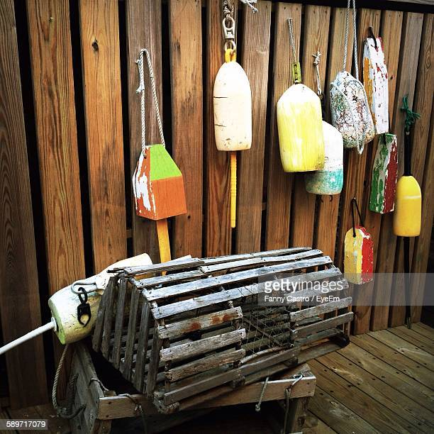 buoys hanging on wooden wall - bar harbor stock photos and pictures