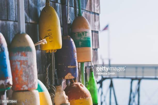 buoys on building - ニューイングランド ストックフォトと画像