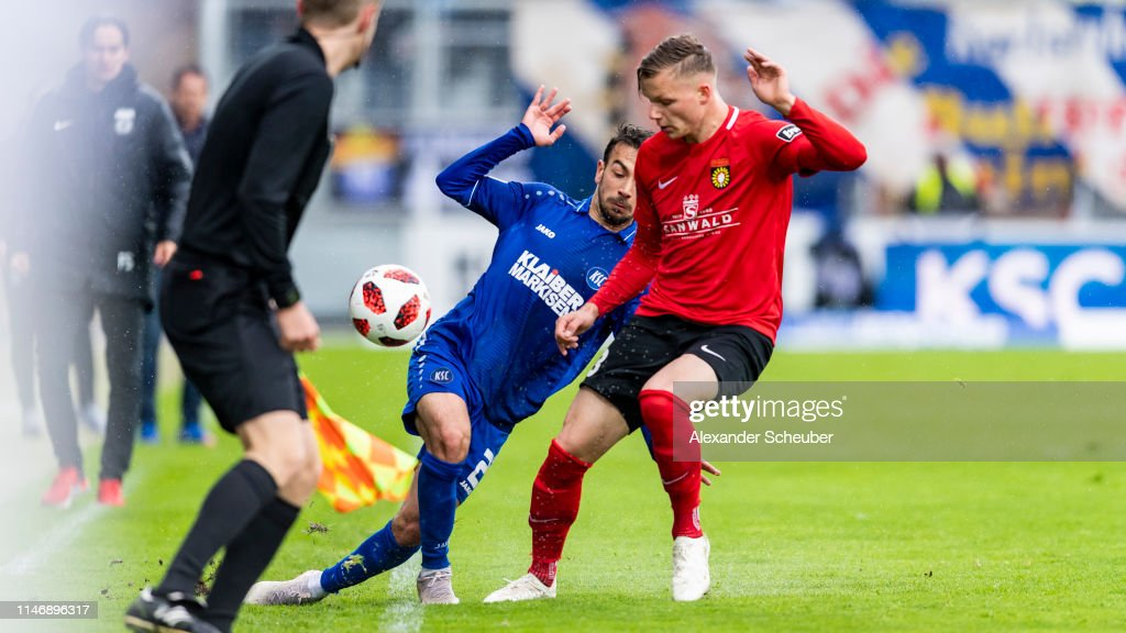 Burak Camoglu Of Karlsruhe In Action Against Kai Bruenker Of News