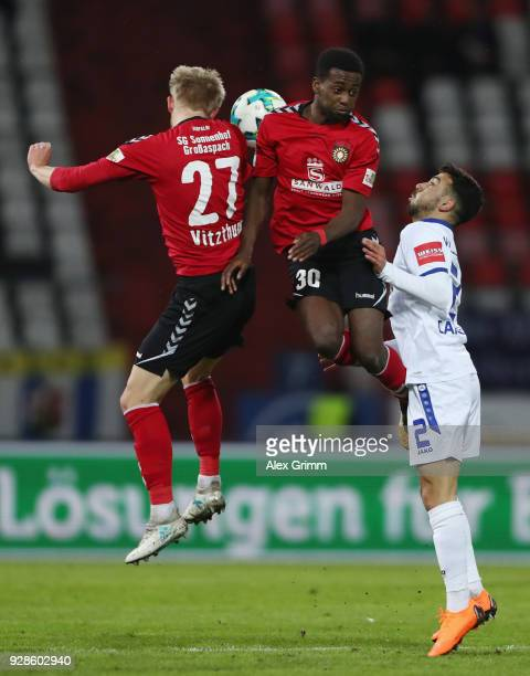 Burak Camoglu of Karlsruhe is challenged by JeffDenis Fehr and Michael Vitzthum of Grossaspach during the 3 Liga match between Karlsruher SC and SG...