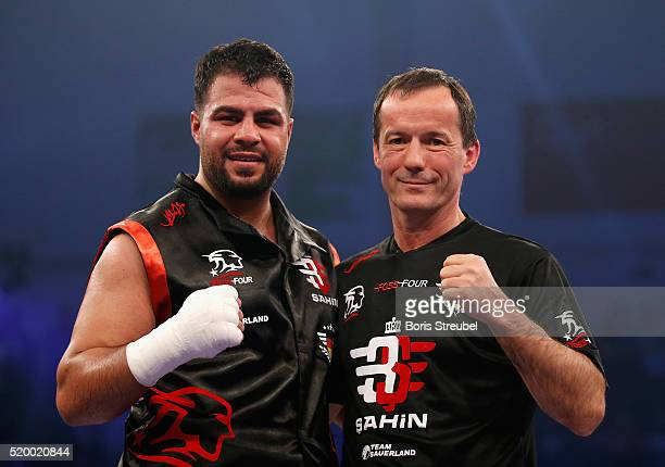 Burak Sahin of Germany celebrates with his coach Karsten Roewer after winning the heavyweight fight against Peter Erdos of Hungary at MBS Arena on...