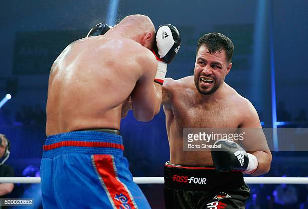 Burak Sahin of Germany exchanges punches with Peter Erdos of Hungary during their heavyweight fight at MBS Arena on April 9 2016 in Potsdam Germany