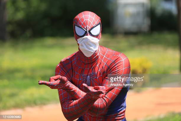 Burak Soylu wearing the Spiderman costume and a facemask as a preventive measure against the coronavirus pandemic poses for a photo in Antalya Turkey...