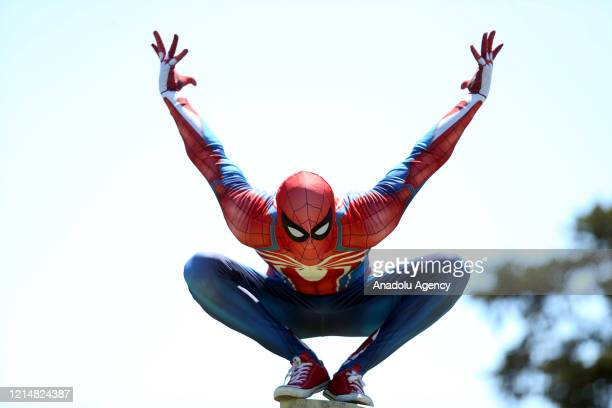 Burak Soylu wears Spider-Man costume and gives candies to children in the last day of Ramadan in Antalya, Turkey on May 23, 2020.
