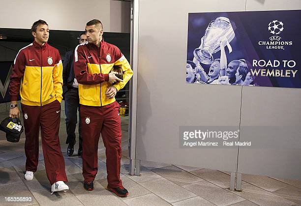 Burak Yilmaz and Fernando Musiera of Galatasaray arrive prior to the UEFA Champions League Quarter Final match between Real Madrid and Galatasaray at...
