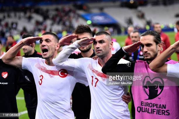 Burak Yilmaz and Merih Demiral of Turkey celebrates with their fans making a military salute after the UEFA Euro 2020 qualifier between France and...