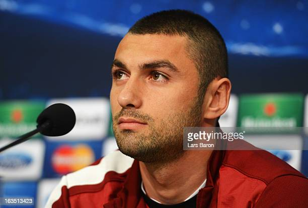 Burak Yilmaz is seen during a Galatasaray AS press conference ahead of their UEFA Champions League round of 16 match against FC Schalke 04 at Veltins...