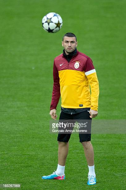 Burak Yilmaz looks the ball during a training session ahead of the UEFA Champions League Quarterfinal match between Real Madrid and Galatasaray AS at...