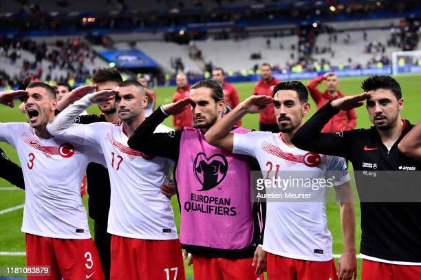 Burak Yilmaz Merih Demiral Irfan Can Kahveci of Turkey celebrates with their fans making a military salute after the UEFA Euro 2020 qualifier between...