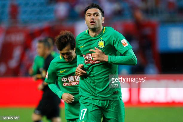 Burak Yilmaz of Beijing Guoan celebrates a point during the 9th round match of 2017 Chinese Football Association Super League between Yanbian Fude...