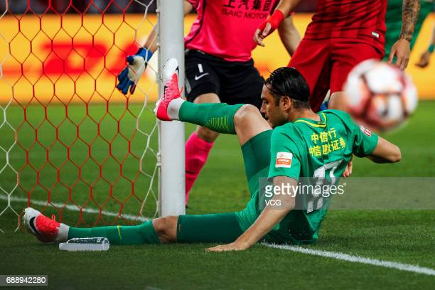 Burak Yilmaz of Beijing Guoan falls down during the 11th round match of 2017 Chinese Football Association Super League between Shanghai SIPG and...