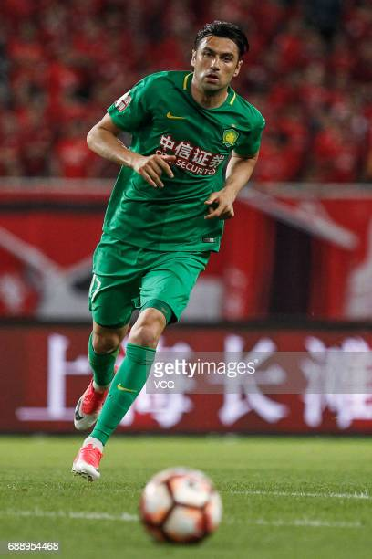 Burak Yilmaz of Beijing Guoan follows the ball during the 11th round match of 2017 Chinese Football Association Super League between Shanghai SIPG...