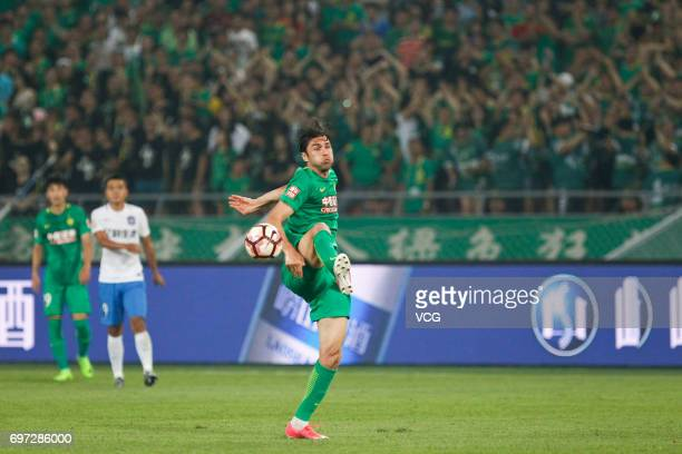 Burak Yilmaz of Beijing Guoan kicks the ball during the 13th round match of 2017 Chinese Football Association Super League between Beijing Guoan and...