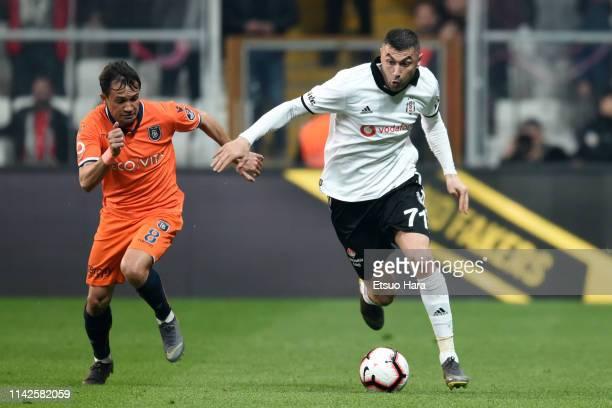 Burak Yilmaz of Besiktas and Jose Marcio Da Costa of Istanbul Basaksehir compete for the ball during the Turkish Super Lig match between Besiktas and...
