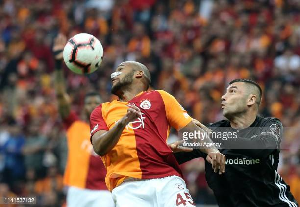 Burak Yilmaz of Besiktas and Marcao of Galatasaray vie for the ball during the Turkish Super Lig week 31 football match between Galatasaray and...