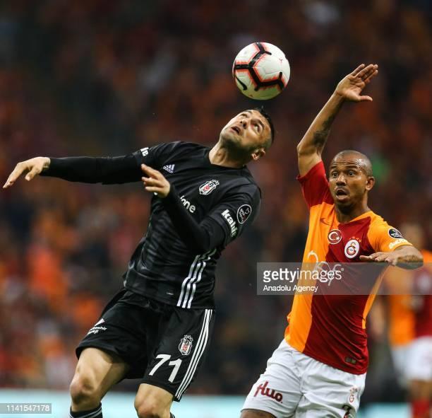 Burak Yilmaz of Besiktas and Mariano Filho of Galatasaray vie for the ball during the Turkish Super Lig week 31 football match between Galatasaray...