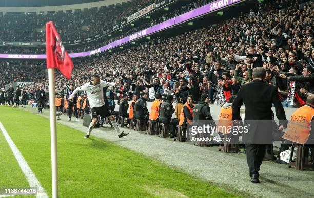 Burak Yilmaz of Besiktas celebrates after scoring a goal with Besiktas fans during Turkish Super Lig soccer match between Besiktas and Medipol...