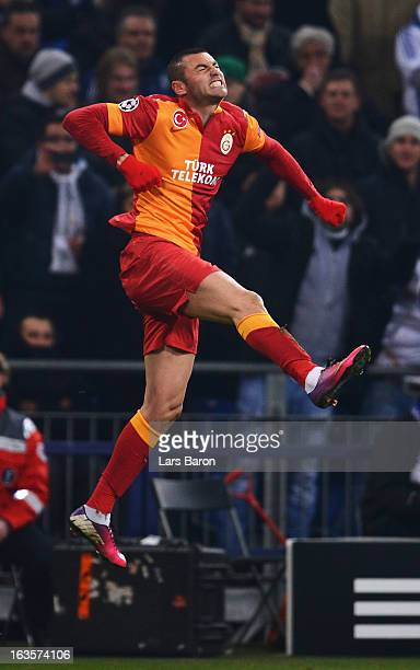 Burak Yilmaz of Galatasaray celebrates after scoring his teams second goal during the UEFA Champions League round of 16 second leg match between FC...
