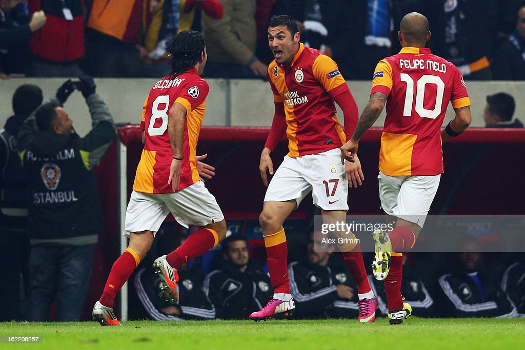 Burak Yilmaz (C) of Galatasaray celebrates his team's first goal with team mates Selcuk Inan (L) and Felipe Melo during the UEFA Champions League Round of 16 first leg match between Galatasaray and FC Schalke 04 at the Turk Telekom Arena on February 20, 2013 in Istanbul, Turkey.