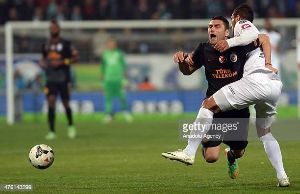 Burak Yilmaz of Galatasaray vies for the ball with Ali Adnan Kadhim AlTameemi of Caykur Rizespor during the Turkish Spor Toto Super League soccer...