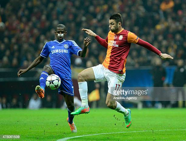 Burak Yilmaz of Galatasaray vies for the ball with Ramires of Chelsea during the the UEFA Champions League round of 2 football match between...