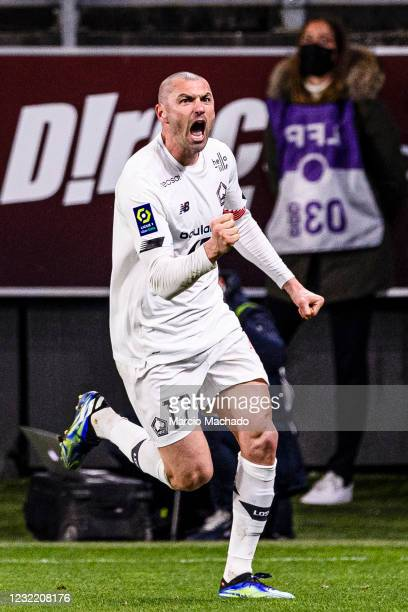 Burak Yilmaz of Lille celebrates his goal during the Ligue 1 match between FC Metz and Lille OSC at Stade Saint-Symphorien on April 9, 2021 in Metz,...