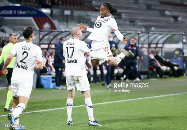 Burak Yilmaz of Lille celebrates his goal with Renato Sanches during the Ligue 1 match between FC Metz and Lille OSC at Stade Saint-Symphorien on...
