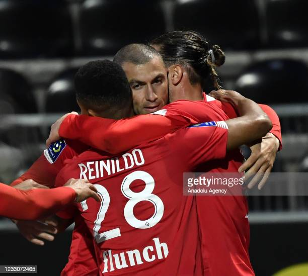 Burak Yilmaz of Lille celebrates his score with his teammate Yusuf Yazici during the French Ligue 1 soccer match between Angers SCO and Lille at...