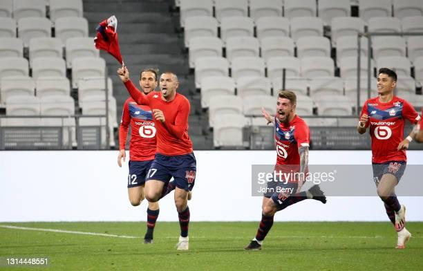 Burak Yilmaz of Lille celebrates his winning goal with Yusuf Yazici, Xeka, Luiz Araujo during the Ligue 1 match between Olympique Lyonnais and Lille...