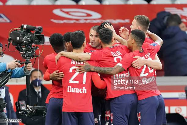 Burak Yilmaz of Lille OSC celebrates with teammates after scoring his team's first goal during the Ligue 1 match between Lille OSC and OGC Nice at...